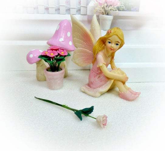 Pink Fairy Rose next to a Pink Fairy