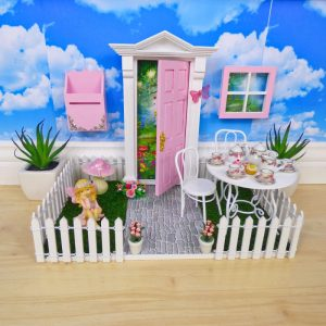 Fairy Door Porch decorated with a fairy door and accessories by Opening Fairy Doors